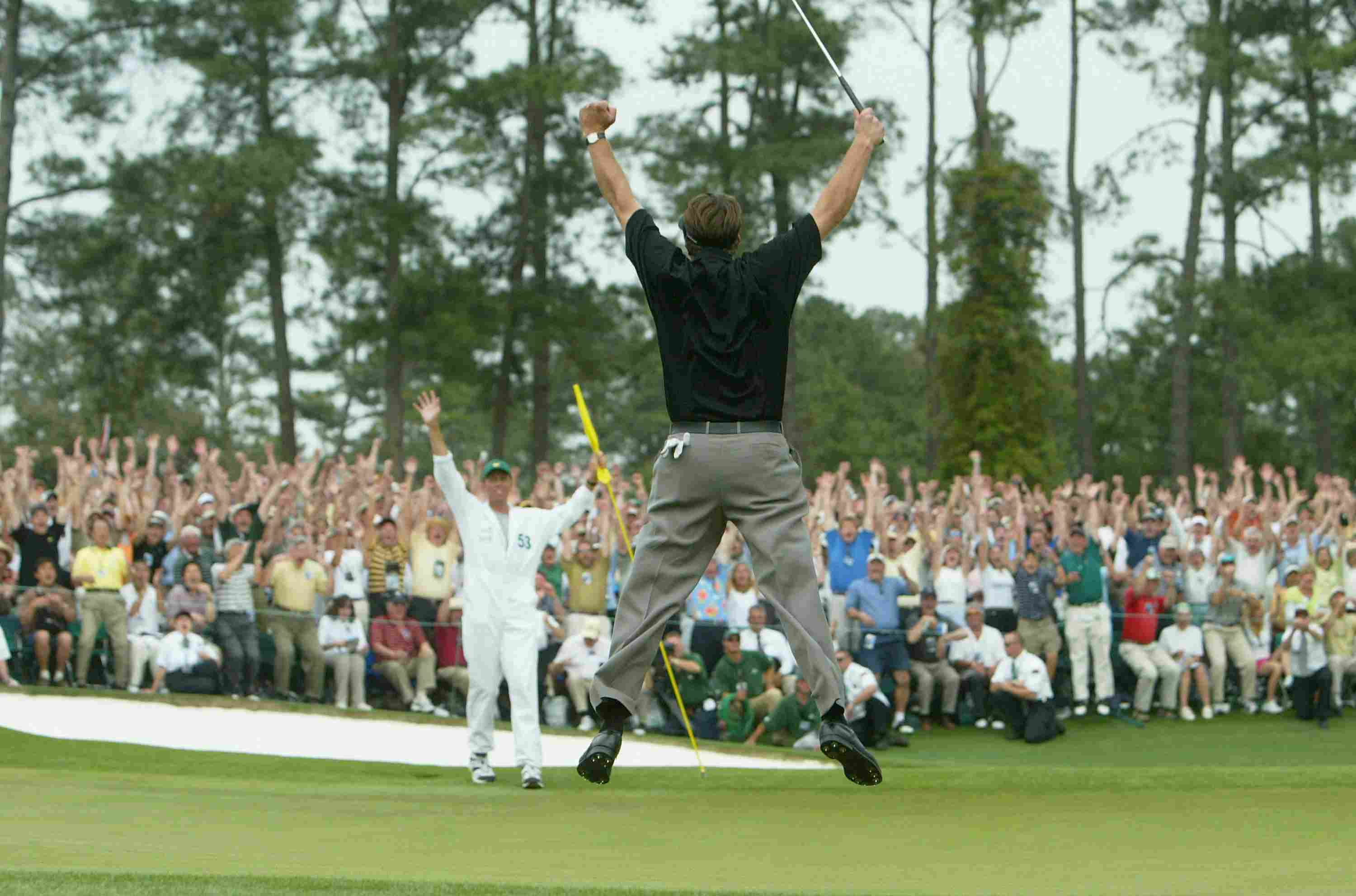 Phil Mickelson jumps in the air after sinking his birdie putt to win the 2004 Masters