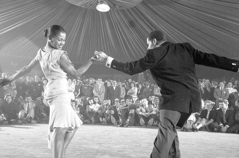 Professional dancers performing the mambo.