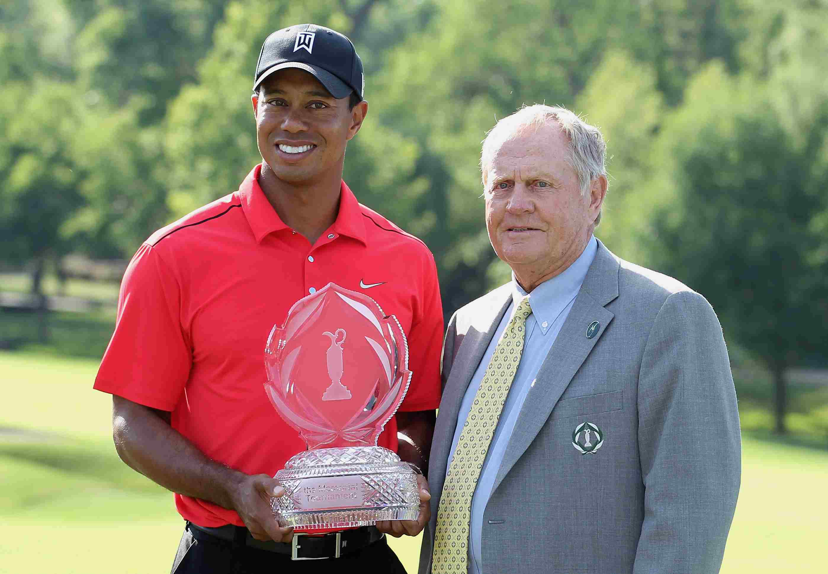 Tournament founder Jack Nicklaus poses with Tiger Woods after Tiger's two-stroke victory at the 2012 Memorial Tournament
