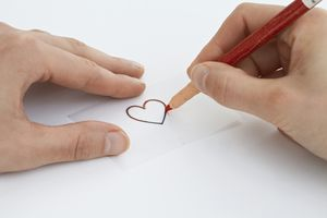 Drawing a glass painting design on a piece of tracing paper using a chinagraph pencil (heart shape)