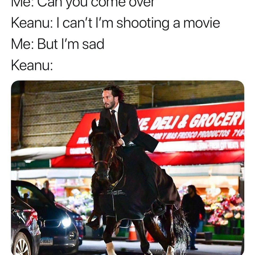 Keanu Reeves riding a horse to save the day