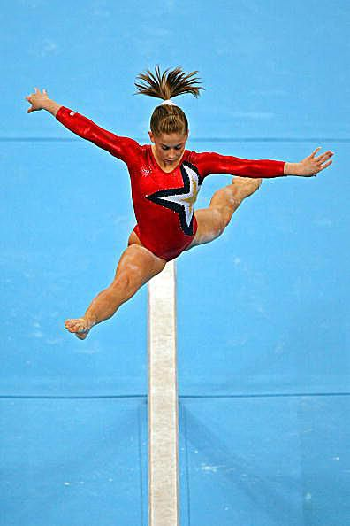 Gymnast Shawn Johnson competes on beam at the 2008 Olympics