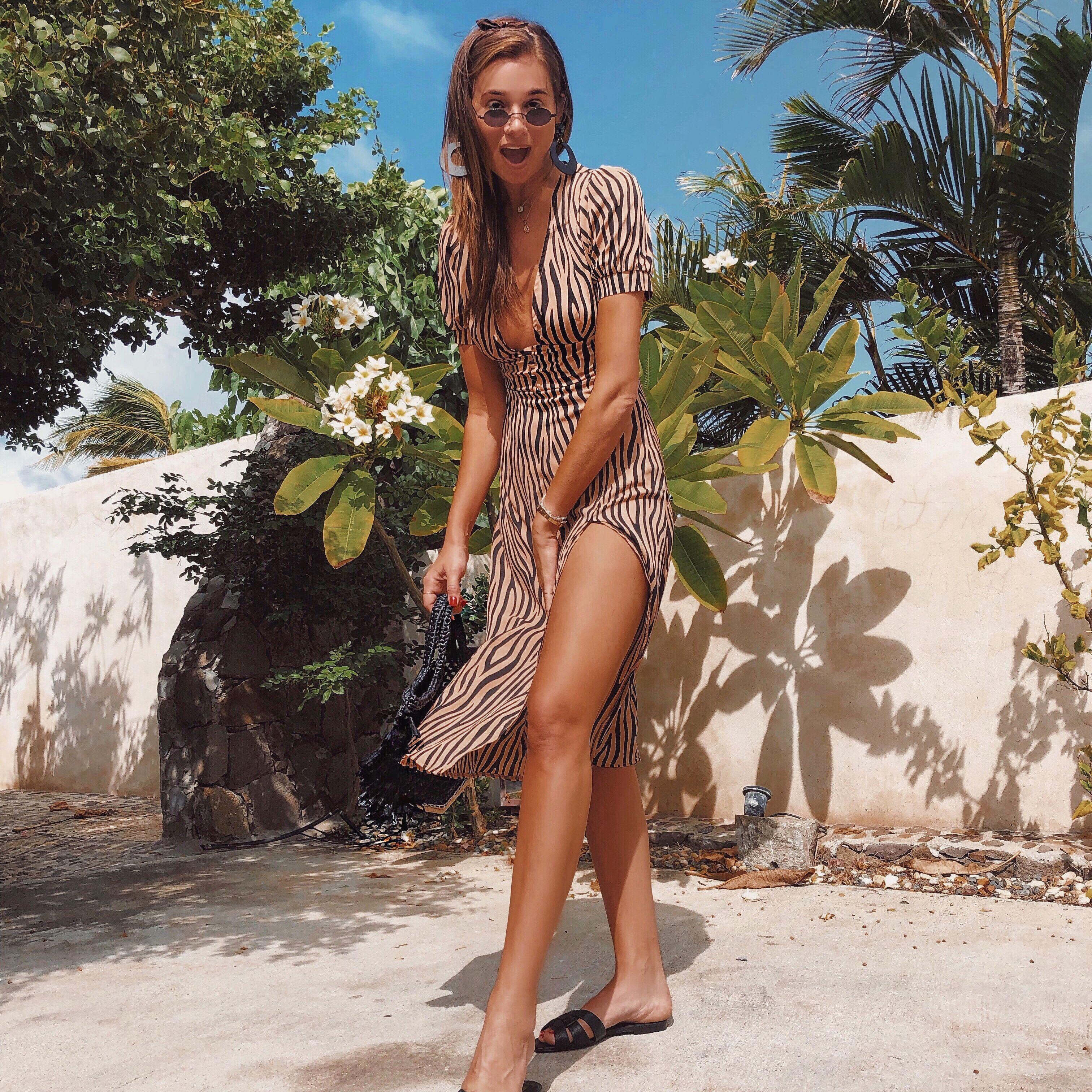 Woman in striped summer dress