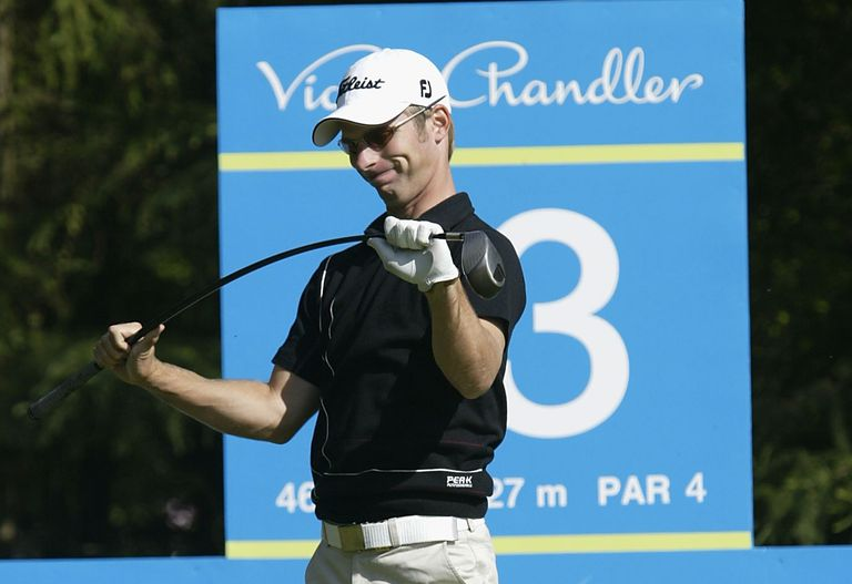 Richard Johnson flexes the shaft of his club in anger during a European Tour tournament