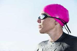 Swimmer wearing goggles and a swim cap