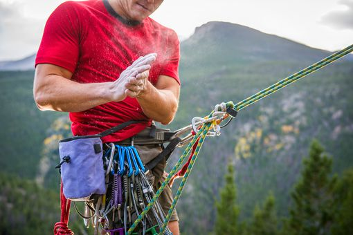 Rock climber getting ready for a climb on a mountain