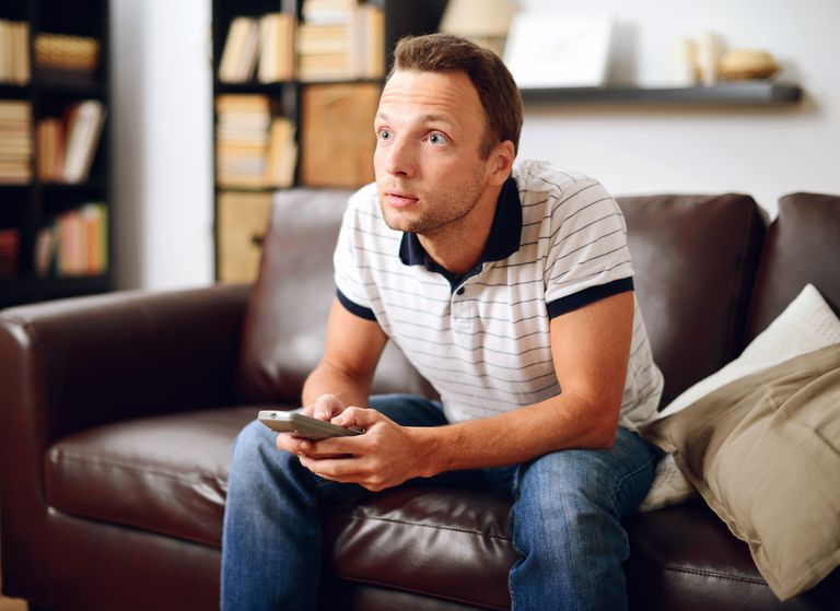 man in home interior Watching TV