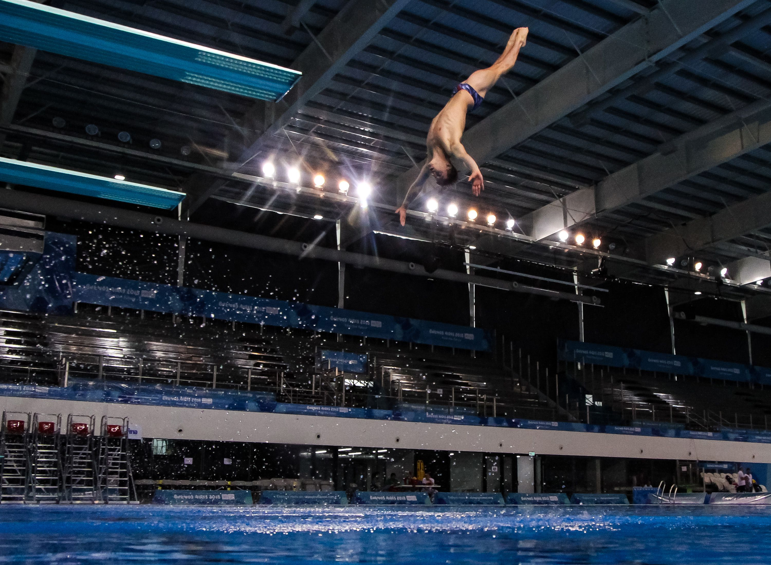 Diver in the middle of performing a reverse dive.