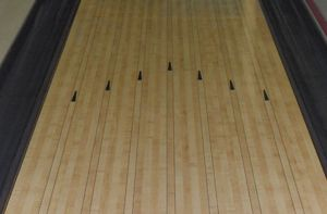 a bowling lane surrounded by gutters