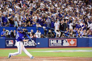 Josh Donaldson swinging his bat at a baseball game