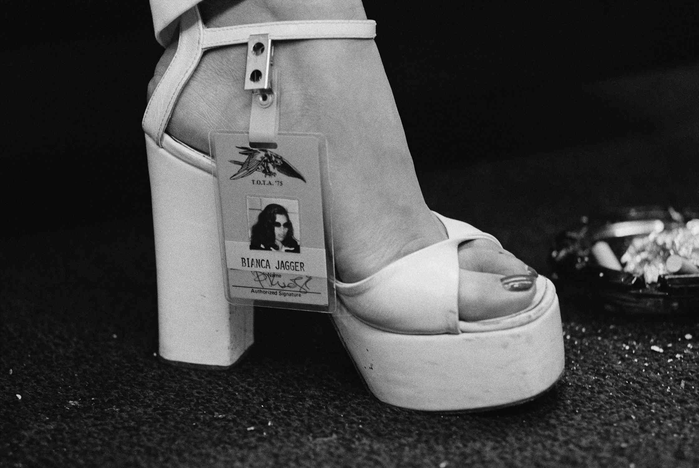 b9833e841d Photo of Bianca Jagger's platform sandal with backstage pass clipped to  ankle strap.
