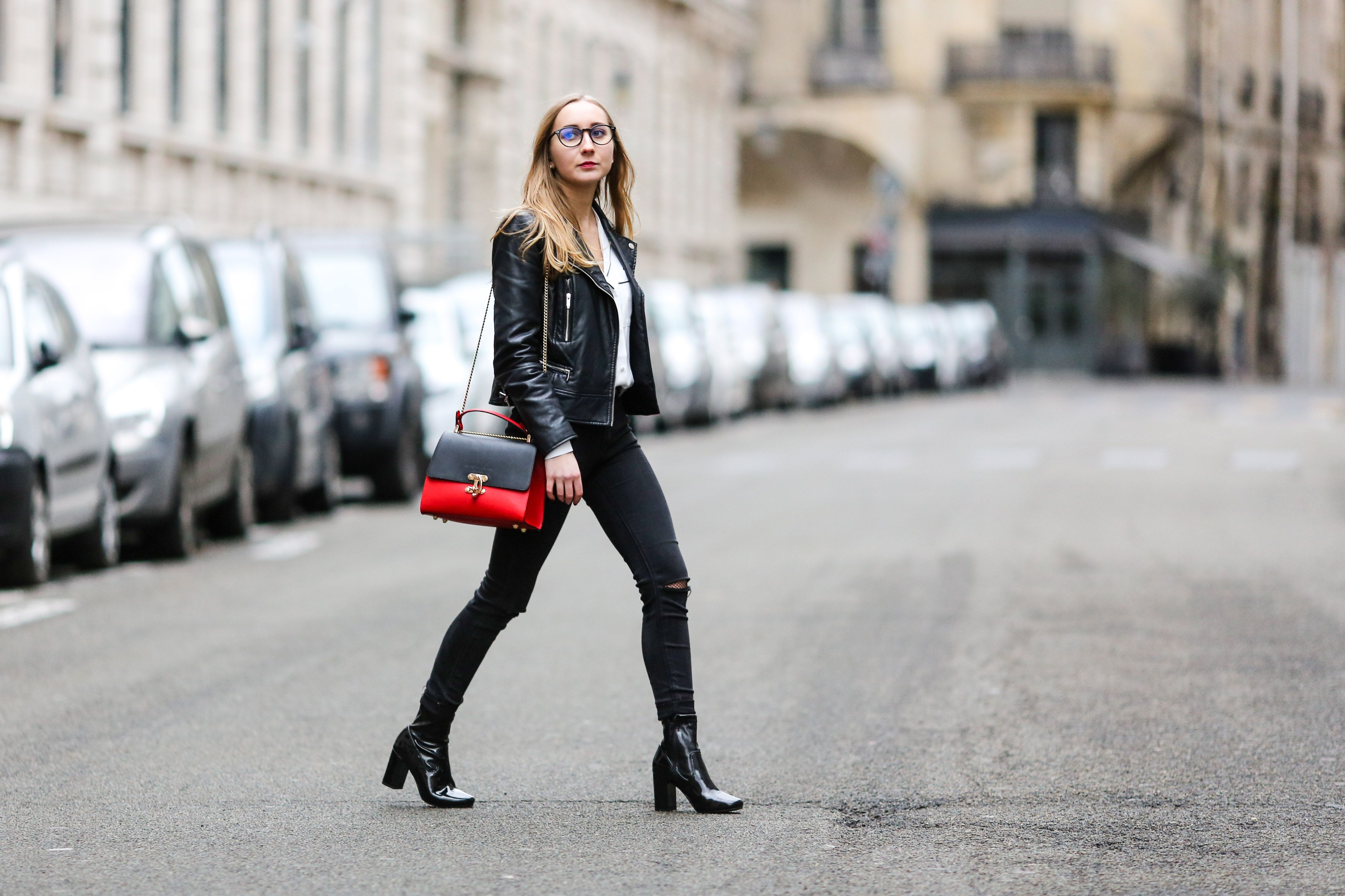 Street style woman in leather jacket and black jeans in Paris France