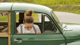 Woman in a Vintage Car