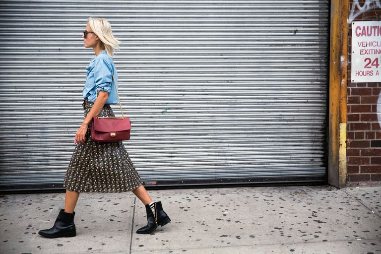 Street style woman in denim shirt and skirt and ankle boots