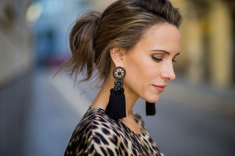 Woman wearing black tassel earrings