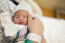 Newborn Infant in Mother's Arms, at Hospital