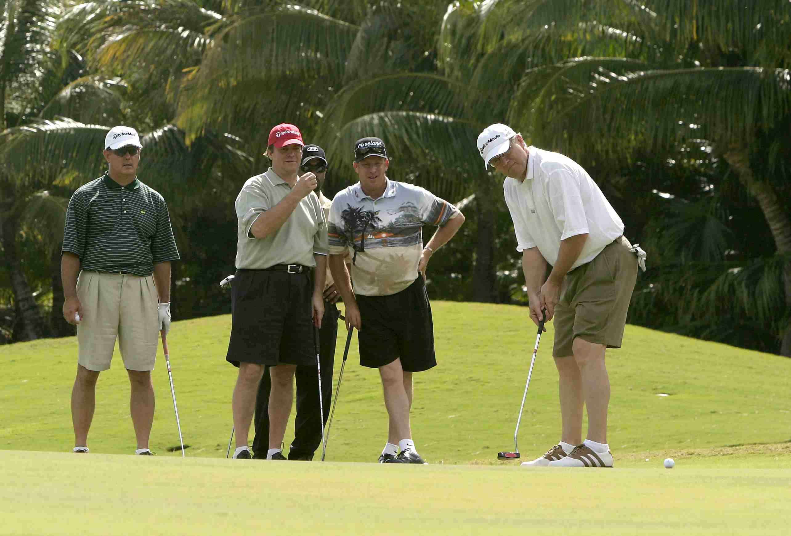 Team of golfers in a scramble tournament