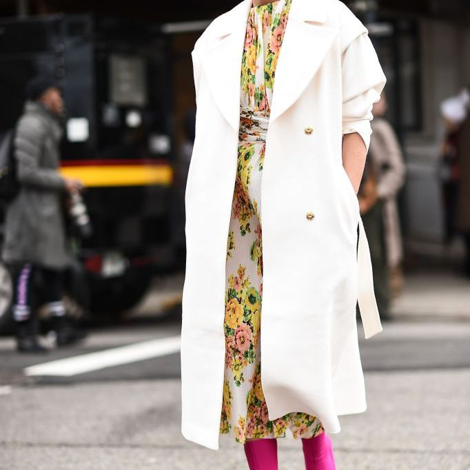 Fall outfit with floral dress and white coat and pink boots