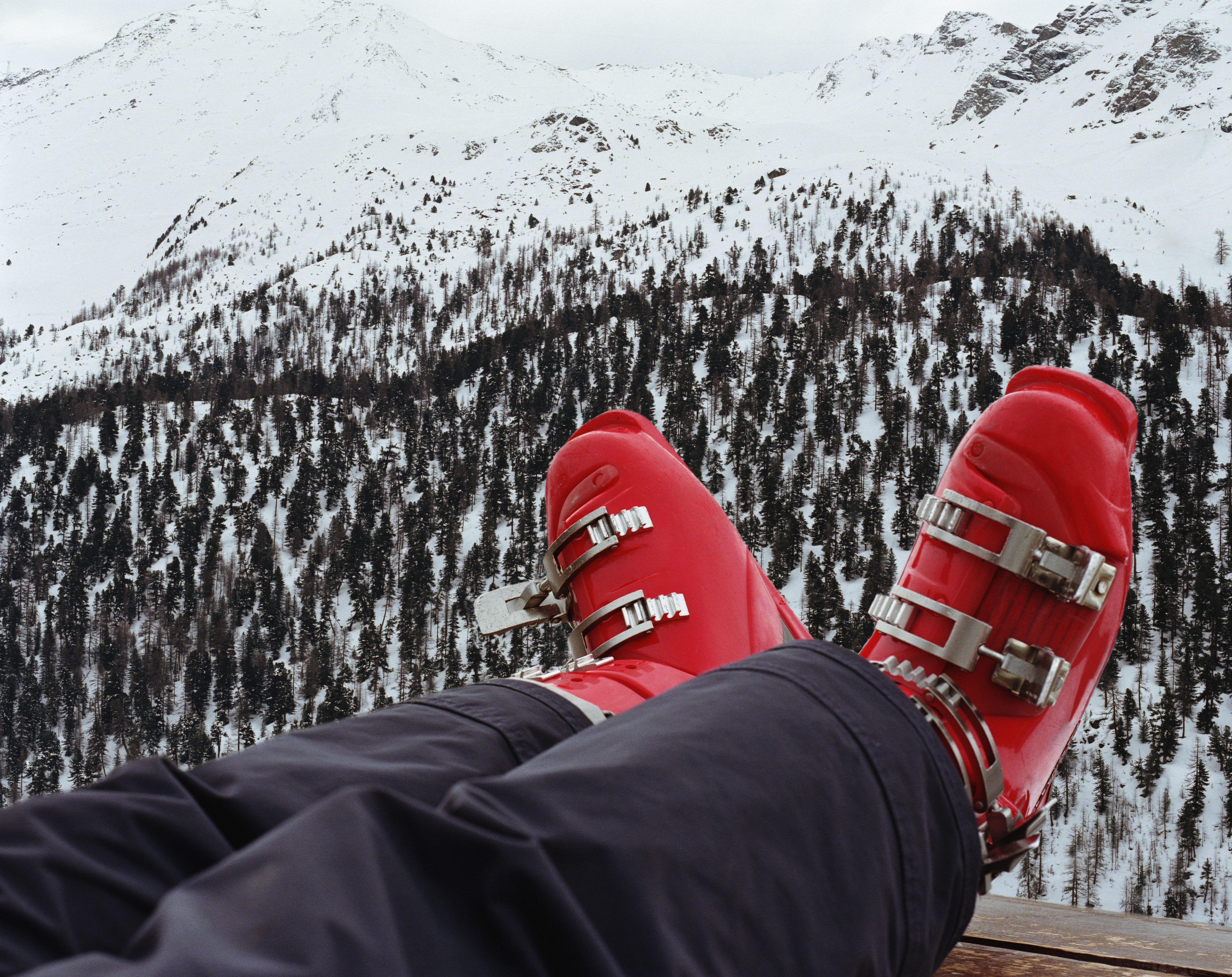 Snowboots on a mountain