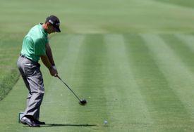 Golfer Charles Howell III plays a stroke