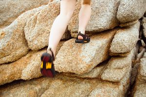 person going rock climbing in sandals