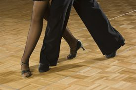 Close up of couple's legs salsa dancing
