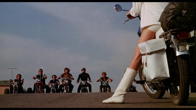 Elizabeth James riding a motorycle in The Born Losers (1967)