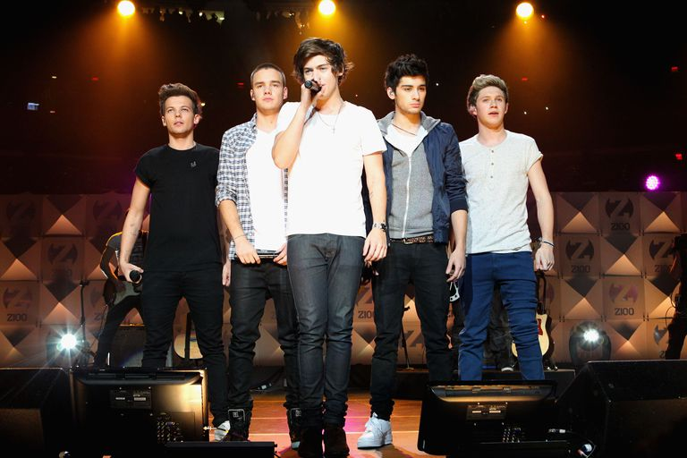 One Direction performing live on stage.