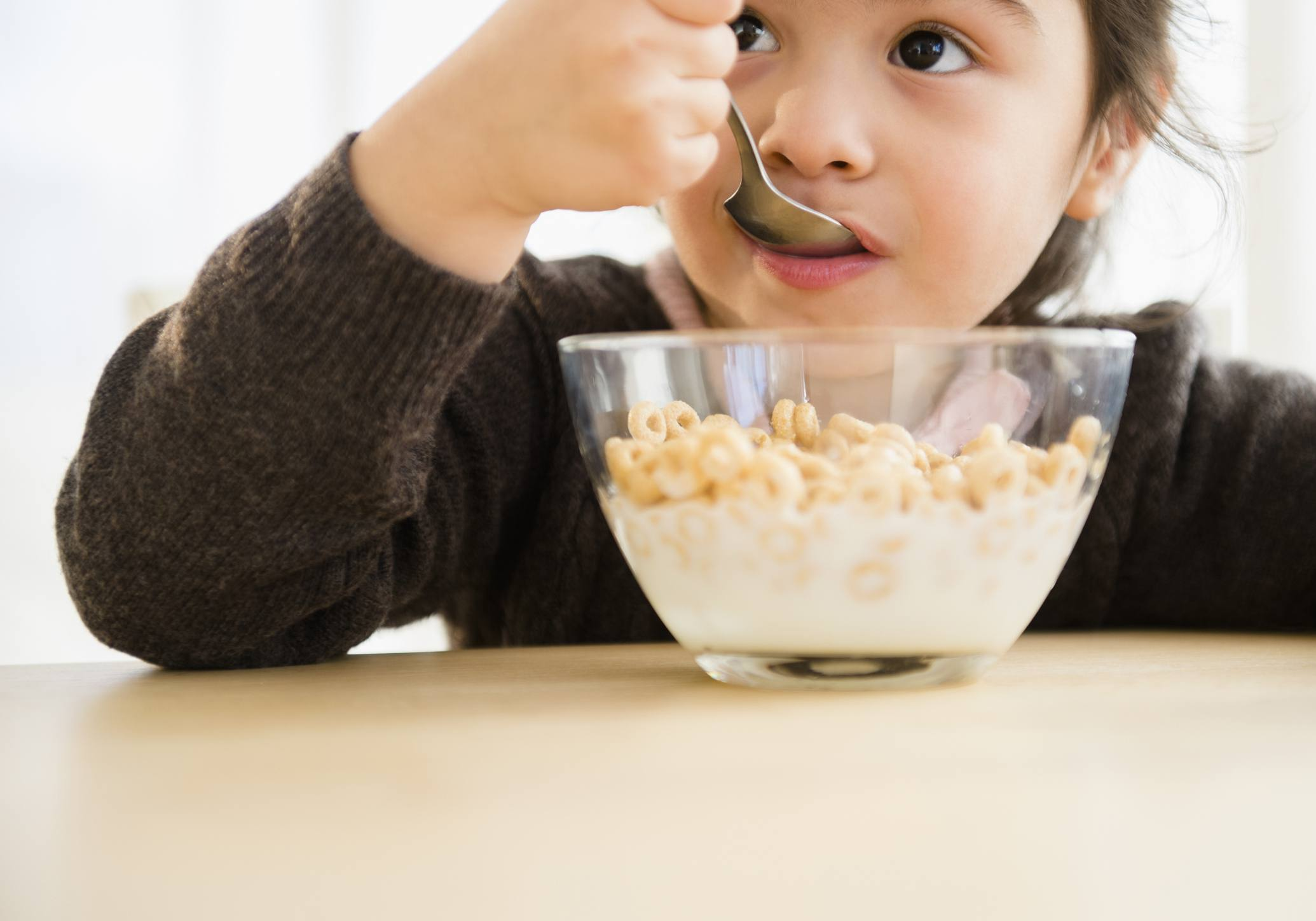 Kid Eating a Bowl of Cereal