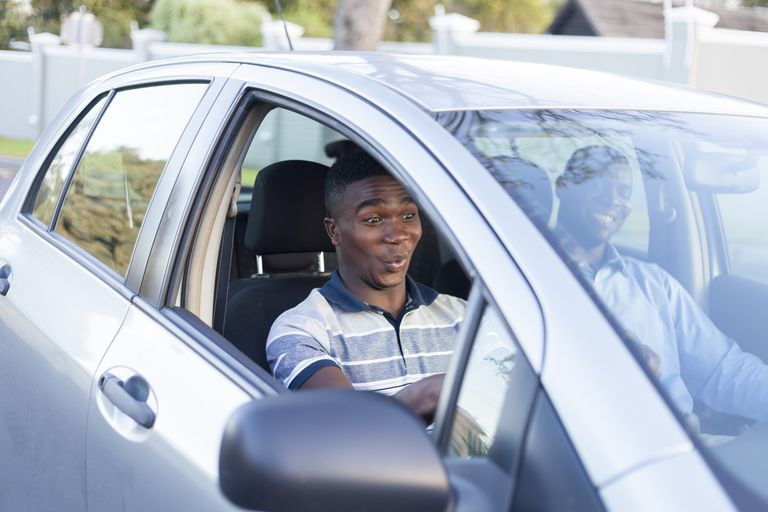 Young african teenage boy learning how to drive , Cape Town, South Africa