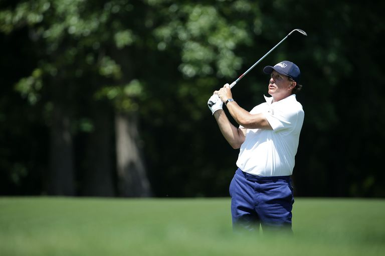 Phil Mickelson hits a wedge shot during a PGA Tour tournament