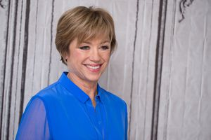 Dorothy Hamill smiling for cameras at a public appearance.