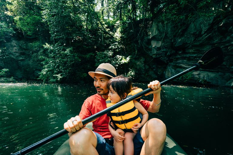 Father and his toddler girl kayaking together, Saitama, Japan