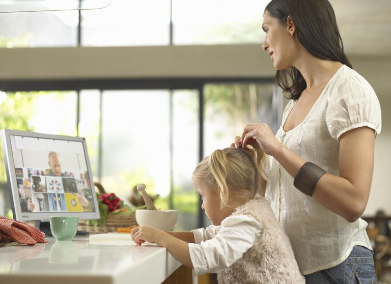 Mother at home with child video conferencing