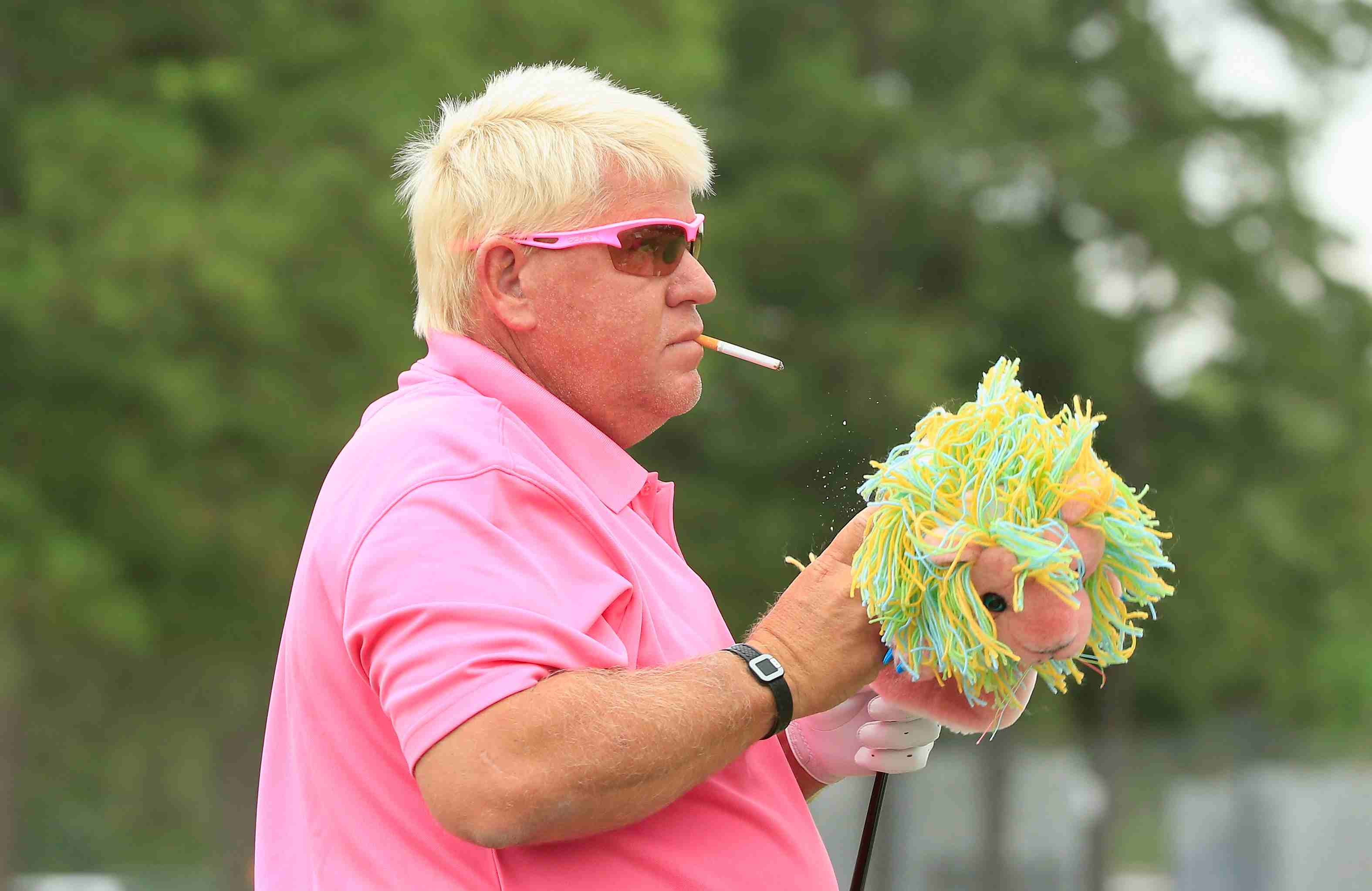 John Daly waits on the practice ground during the final round of the Insperity Invitational at The Woodlands Country Club on May 8, 2016