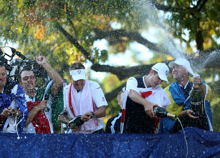 Francesco Molinari, Ian Poulter and Nicolas Colsaerts of Europe celebrate after winning The 39th Ryder Cup at Medinah Country Club on September 30, 2012
