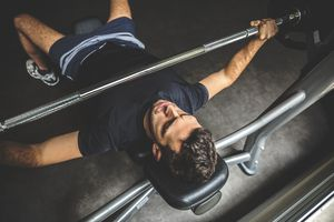 A man bench pressing a barbell