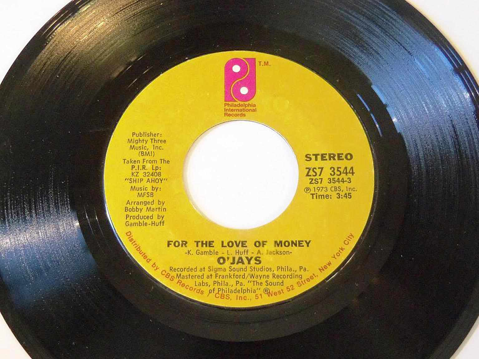 """Close up of The O'Jays' """"For the Love of Money"""" record."""