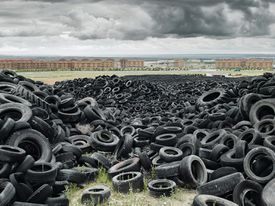 Pile of Old Tires Outside of City