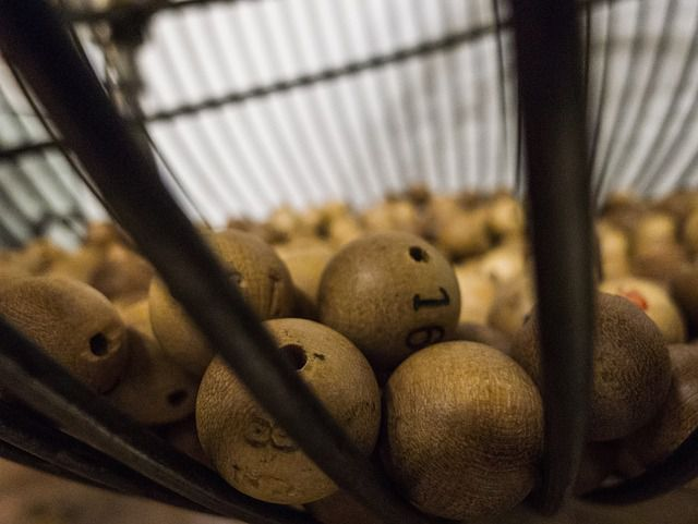 Image of grim-looking lottery balls.