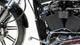 Close-Up Of Motorcycle Against White Background
