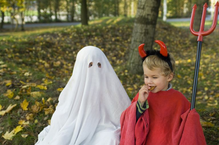 Two kids in Halloween costumes