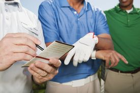 Three golfers in a flighted tournament comparing scores