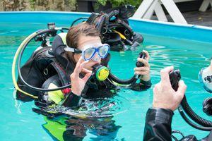 Student scuba diver in swimming pool