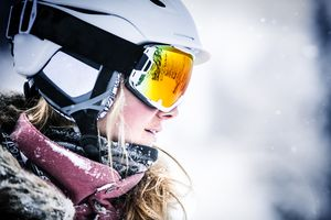 a skiier wearing goggles and a helmet