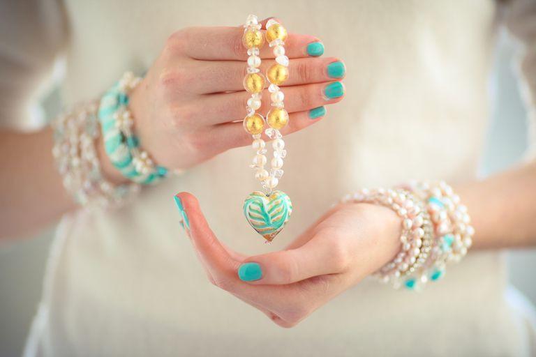 Girl Holding Heart Pendant Necklace