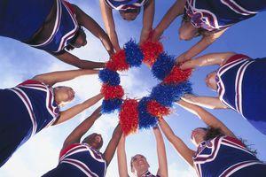 Cheerleaders Holding Pom-Poms