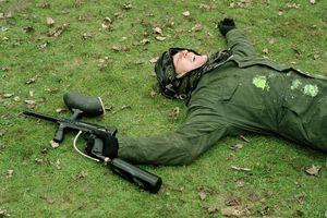 Paintballer lying on grass
