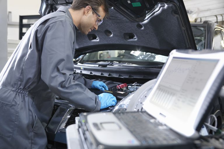 Modern Automobile Repair Technicians Diagnose and Program Vehicles