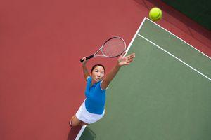 woman tennis player serving